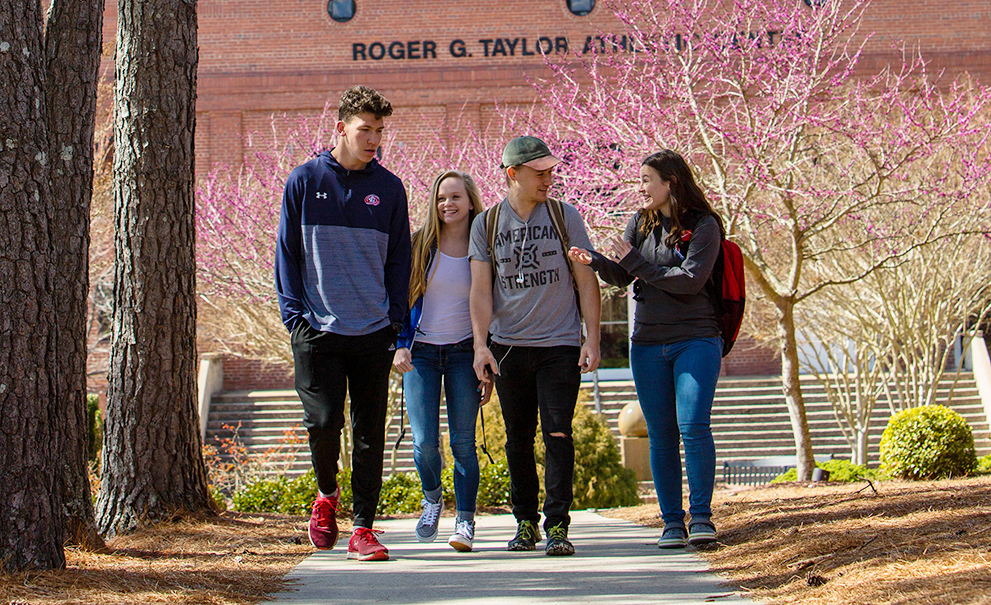 students walking on sidewalk