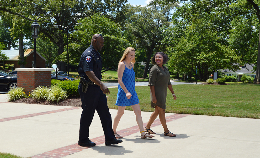 officer walking with students